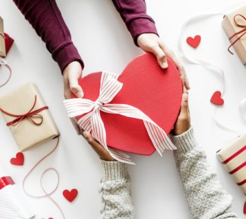Love and romance concept giving a present